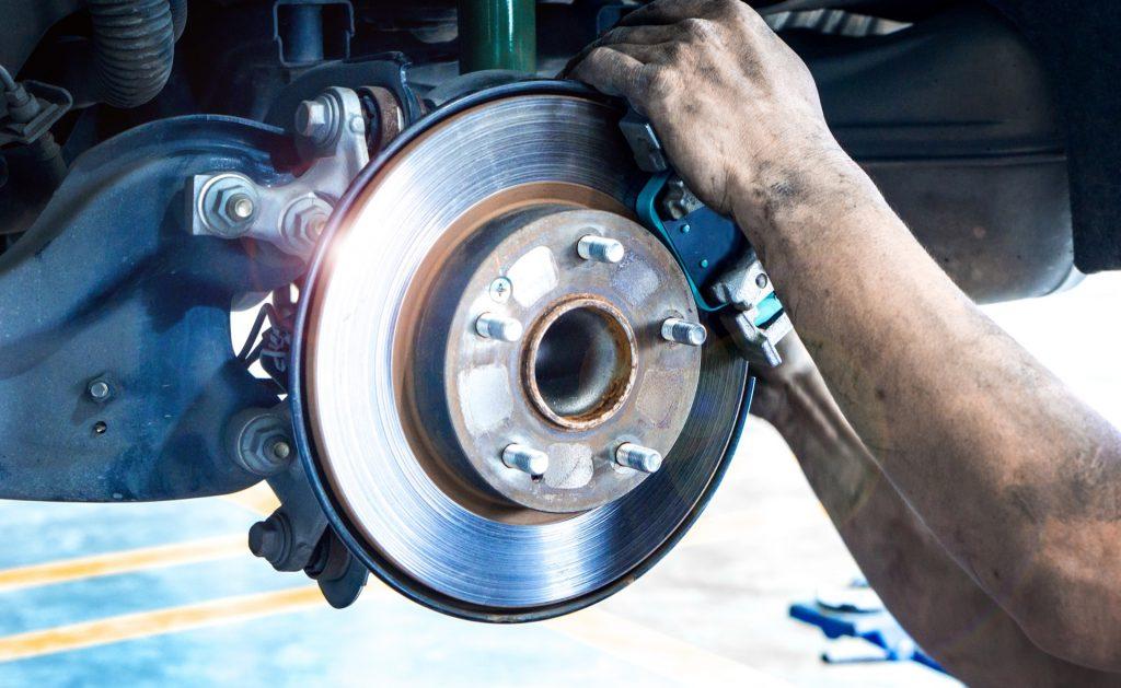 Replacing old brake pads on car