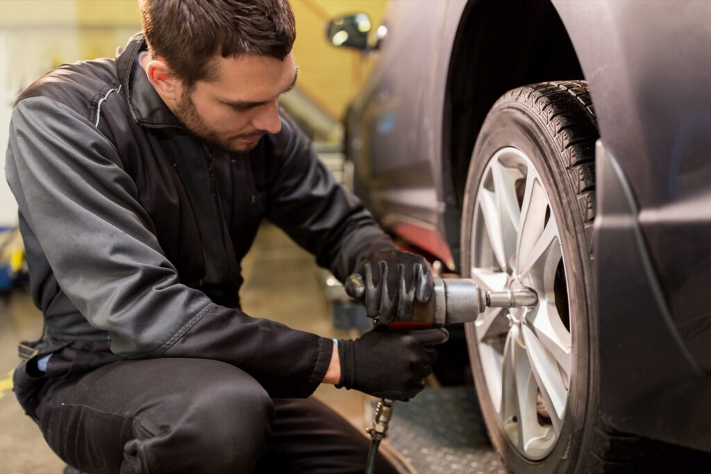 Mechanic mounting summer tires