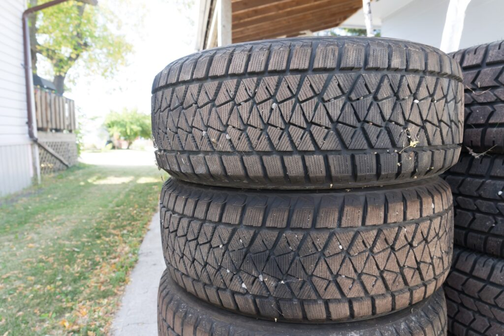 Stacked winter tires stored outdoors